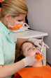 Dentist using dental UV curing light led laser dental procedure