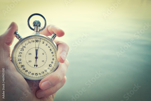 Old chronometer in man hand, vintage  style - 66965000