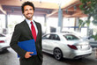 Salesman in a car showroom - 66966047