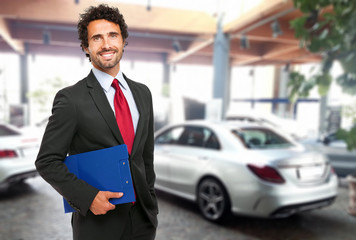 Salesman in a car showroom