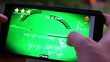 Woman hand using mobile phone touch screen. Playing game