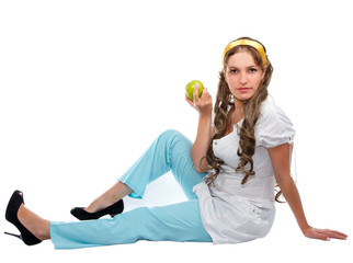 Beautiful woman in medical uniform with an apple