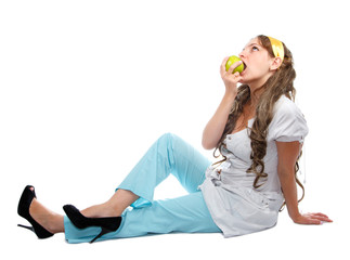 Charming nurse eating apple on the floor