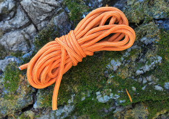 orange binding rope on stone