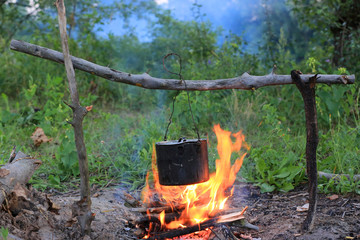 Tourist kettle on camp fire