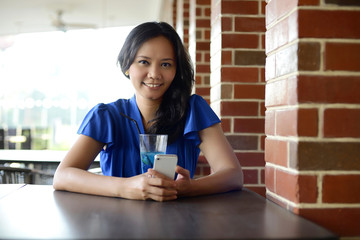 Young asian woman at restaurant