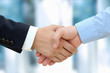 Leinwanddruck Bild - Close-up image of a firm handshake  between two colleagues