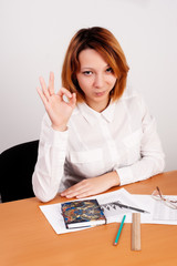 business analyst woman with ok gesture