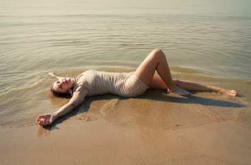 Woman  lies on the seashore