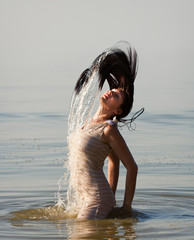 woman in the sea splashing water