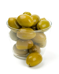 green olives in a glass bowl over white
