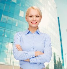 young smiling businesswoman with crossed arms