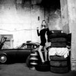 fashionable woman in retro garage