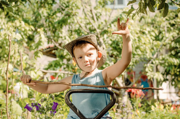 Young boy playing with a stick and gesturing