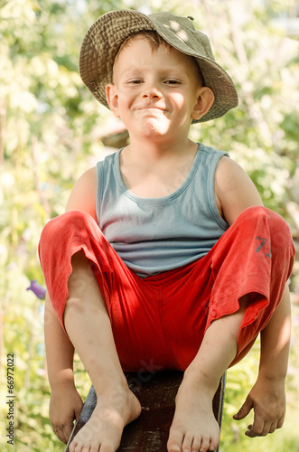 Cheeky young barefoot country boy
