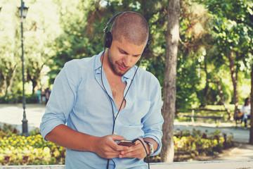 Handsome guy using smart phone
