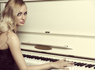 elegant girl near piano