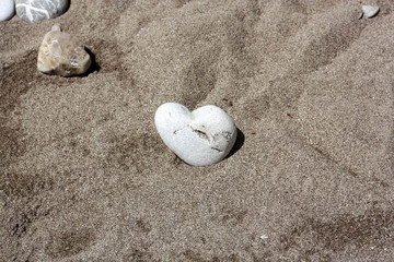 Little Stone Heart in Sand
