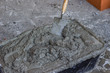 plastic cement mixing trough full with mortar