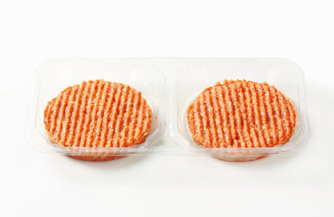 Raw burger patties
