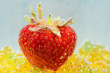 strawberry with bubbles on a blue background