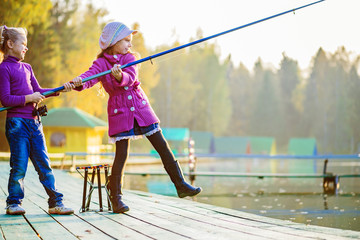 little girls catches fishing rod