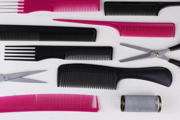 Professional hairdresser tools  on color wooden background