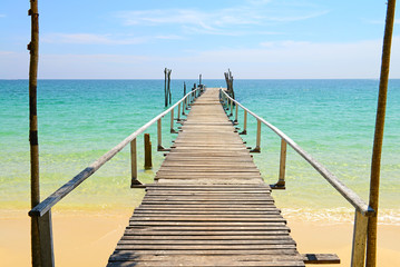 Wooden jetty on the sea © opasstudio