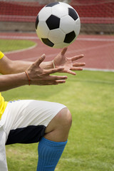 Soccer'hands reaching the foot ball