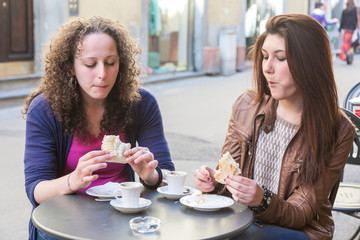 Girls Having Italian Traditional Breakfast at Bar