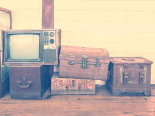 retro tv and boxes on wooden floor, vintage style