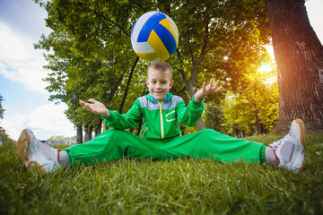 little boy having fun playing soccer with ball