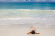 Young woman lying on tropical beach