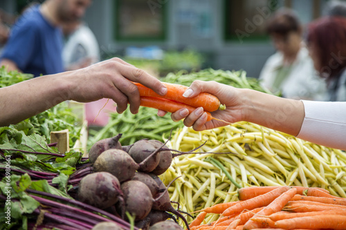 canvas print picture Woman buying vegetables on the market