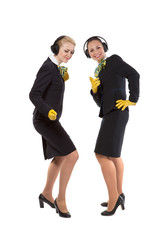 two cheerful stewardess listen to music