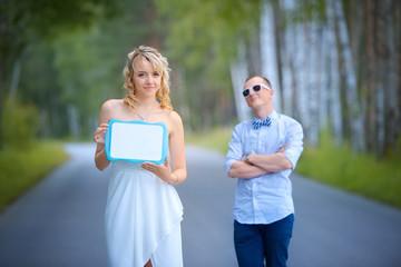 Bride holding nameplate