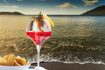 cocktail on solitary beach in peloponnese