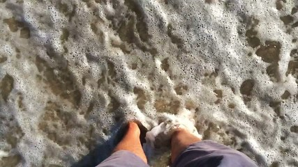 Standing in the water on a beach in Mallorca - Slow motion