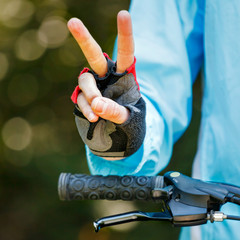 Biker showing victory sign - cycling concept image