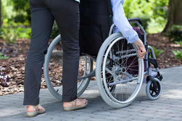 Person on a wheelchair and guardian