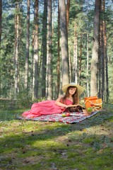 Woman Read Book And Enjoying Outdoor Picnic