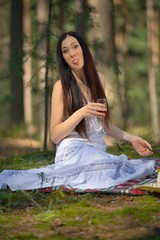 Beautiful caucasian woman at picnic in forest