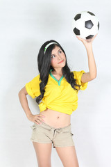 Portrait Beautiful woman hold ball over her head with wearing Br