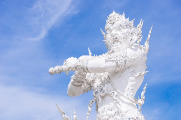The statue of giant guardian in Wat Rong Khun, the famous white