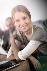 Portrait of beautiful blond girl in class