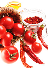Mediterranean Food: cherry tomatoes and dried hot chili peppers