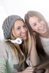 Girlfiends having fun listening to music