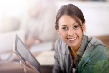 Young woman using tablet in business training