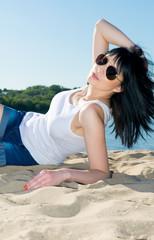 Girl in sunglasses on the beach