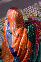 woman draped in colorful saree , Rajasthan, India